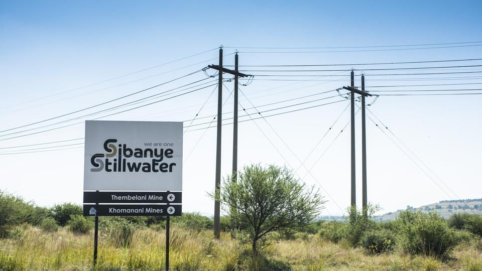A sign directs to the Sibanye-Stillwater Thembelani and Khomanani platinum mines, operated by Sibanye Gold Ltd., at the roadside in Rustenburg, South Africa, on Wednesday, April 22, 2020. South Africa allowed mining companies to resume operations at half their normal capacity as the government takes its first steps to ease a nationwide coronavirus lockdown.