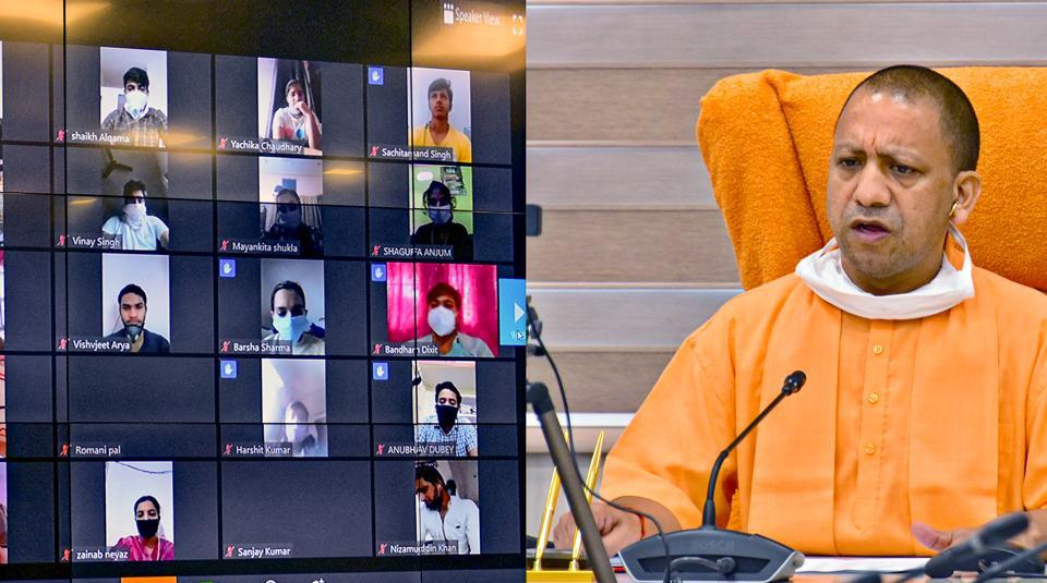 Uttar Pradesh Chief Minister Yogi Adityanath interacts with students who were brought back to their homes from Kota, via video conferencing in Lucknow on Tuesday.
