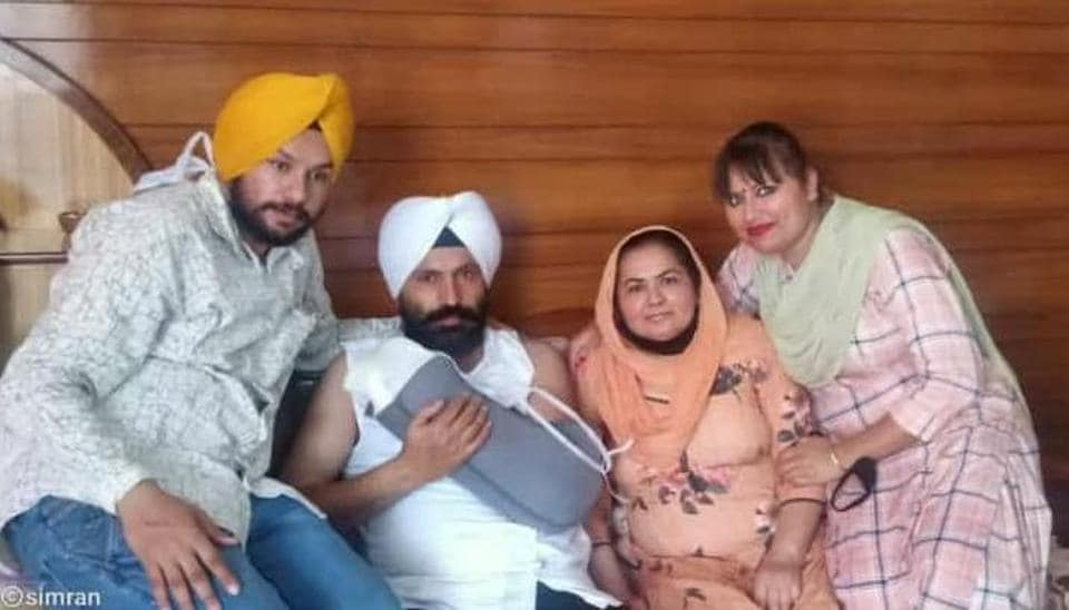 Sub-inspector Harjeet Singh with his family in Patiala on Thursday.
