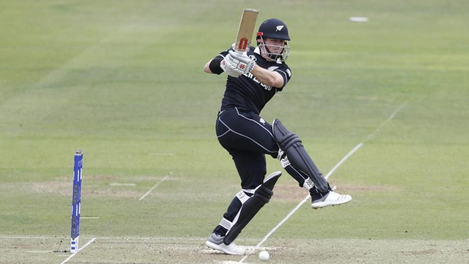 New Zealand's Henry Nicholls plays a shot off the bowling of England's Mark Wood during the Cricket World Cup final match between England and New Zealand.