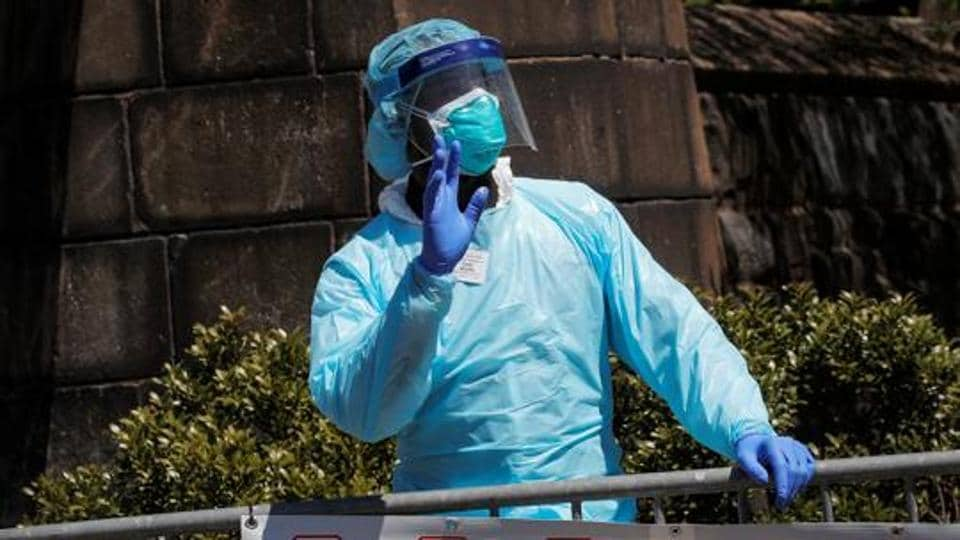 A healthcare worker greats people outside the Brooklyn Hospital Center, during the outbreak of coronavirus disease (COVID-19) in the Brooklyn borough of New York City, New York, US,  April 28, 2020.