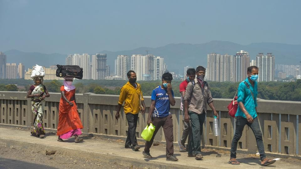 Migrant workers from Akola district of Maharashtra walk along Mumbai-Nashik highway to reach their native places, during a nationwide lockdown in the wake of coronavirus, in Thane.