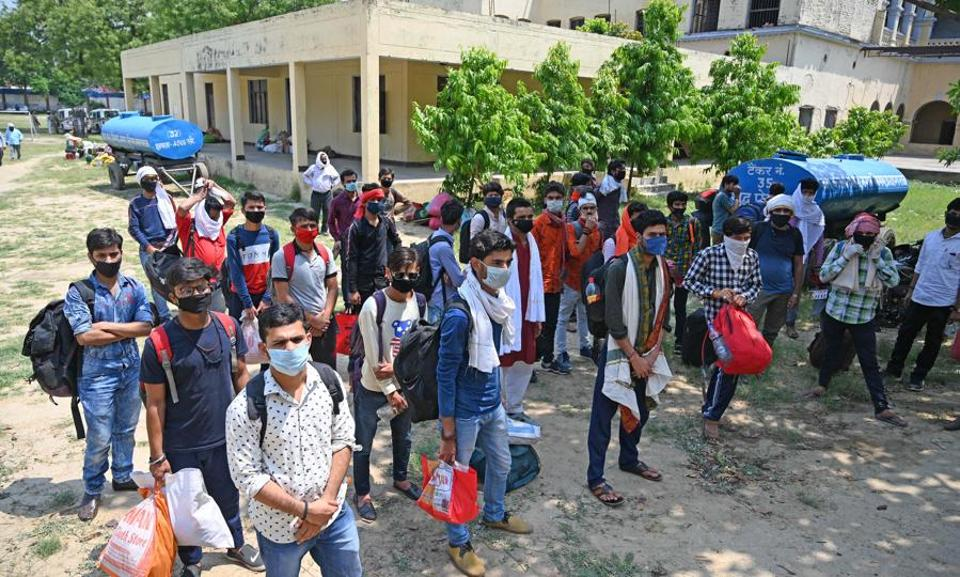 Students of Madhya Pradesh who stranded in various districts of Uttar Pradesh waiting to board buses arranged by Madhya Pradesh government to go their native villages.