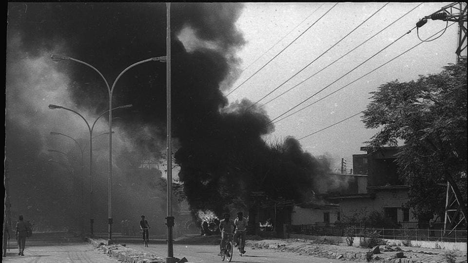 Smoke bellows from a street in New Delhi in November 1984 during the anti-Sikh riots.