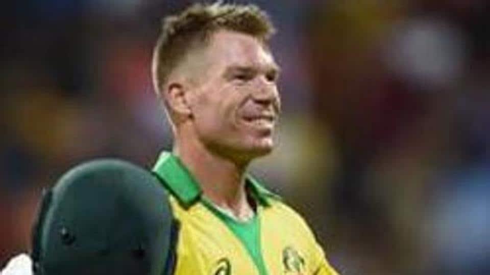 Australia batsman David Warner celebrates his century.