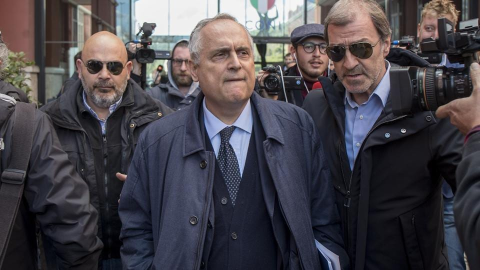 Lazio soccer team's CEO Claudio Lotito, center, leaves following an Italian Soccer League's meeting in Rome, Wednesday, March 4, 2020.