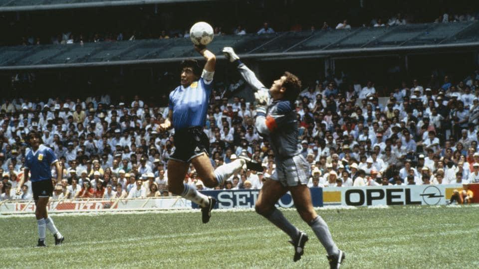 Argentina's Diego Maradona scores 1st goal with his Hand of God, past England goalkeeper Peter Shilton.