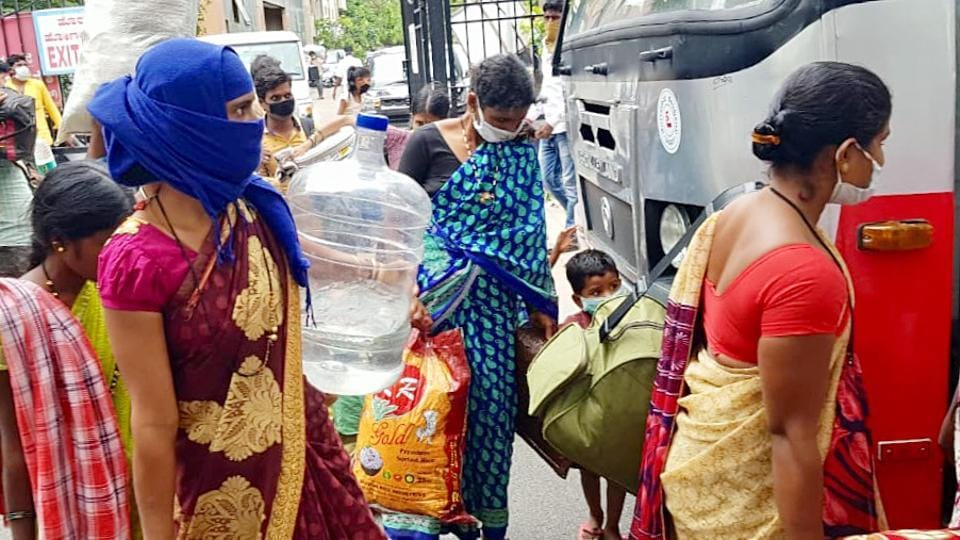 Migrant labourers board buses as they are allowed to travel to their native place during the nationwide Covid-19 lockdown in Bengaluru on Wednesday.