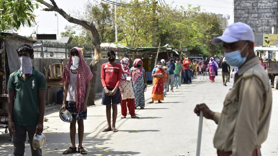 Homeless people stand in a queue. (Representative Image)