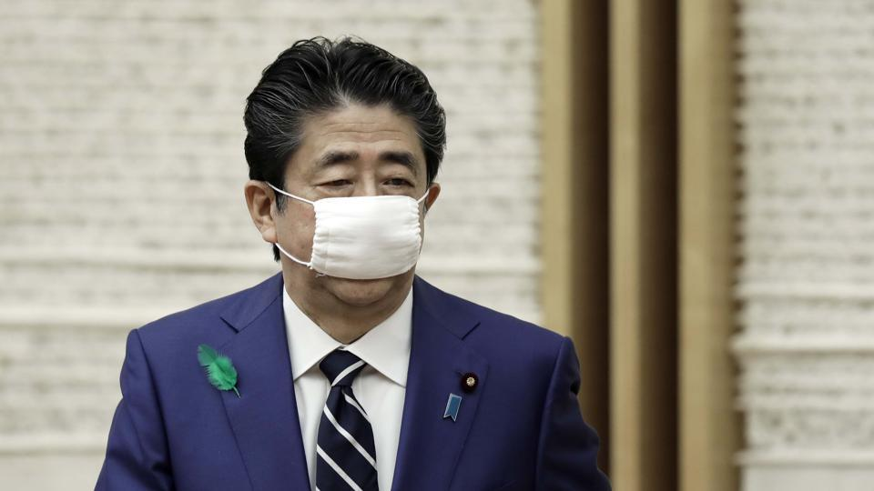 Japanese Prime Minister Shinzo Abe wearing a protective mask as a precautionary measure amid Covid-19 outbreak.