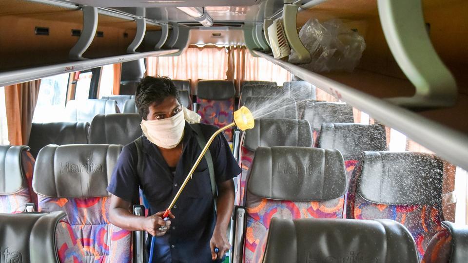 Andhra Pradesh Mar 16 (ANI): A cleaning staff member sprays disinfectant on a bus in wake of coronavirus pandemic at busdepot in Vijayawada.