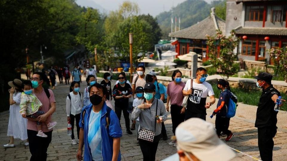 Tourists visit the Mutianyu section of the Great Wall of China on the first day of the five-day Labour Day holiday following the coronavirus disease (COVID-19) outbreak, on the outskirts of Beijing, China May 1, 2020. REUTERS/Thomas Peter
