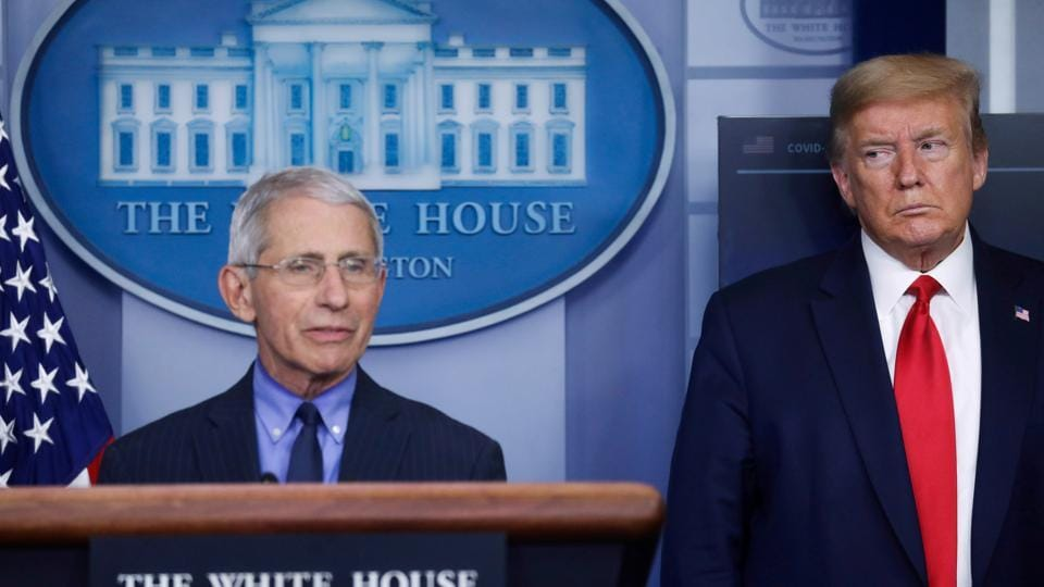 File photo  of US  President Donald Trump with  National Institute of Allergy and Infectious Diseases Director Dr. Anthony Fauci as Fauci answers a question during the daily coronavirus task force briefing at the White House in Washington, U.S., April 17, 2020.