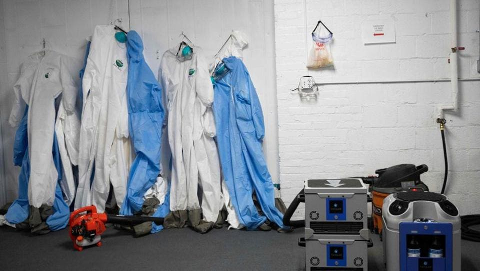 PPE suits are seen next to a decontamination unit, at the Washington, DC Fire and Emergency Medical Services Department's decontamination facility, in Washington, DC, on April 15, 2020.