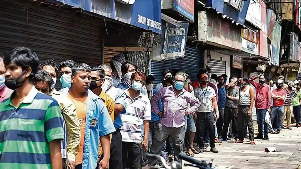 People wait in a long queue outside a liquor shop in Daryaganj, New Delhi,  as some relaxations were allowed in lockdown norms, Monday, May 4, 2020.