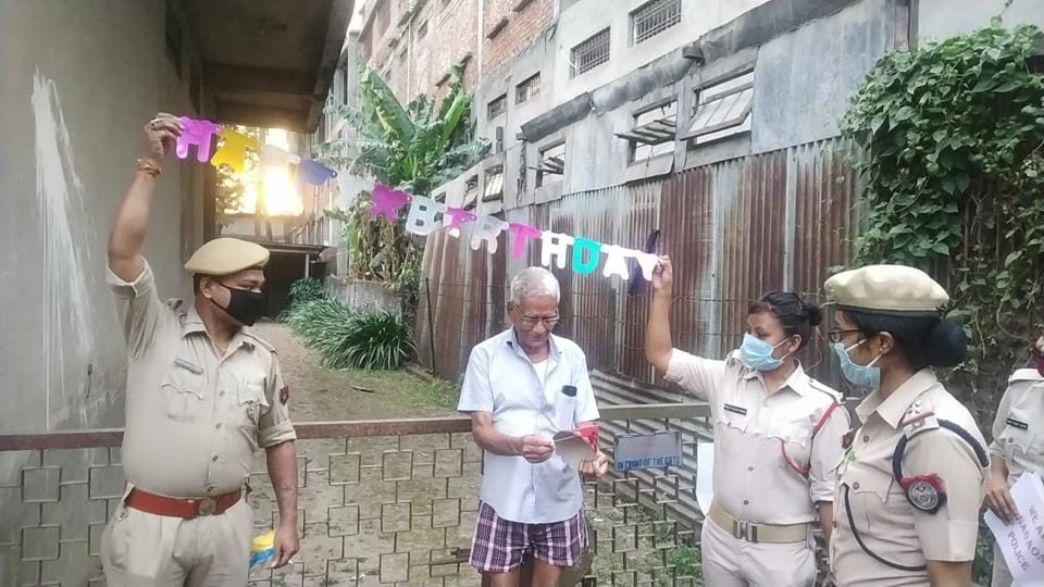 Two police personnel are seen holding a Happy Birthday banner for KP Agarwal in Assam's Nagaon. They helped Agarwal, whose family is stranded across the country, celebrate his 78th birthday.