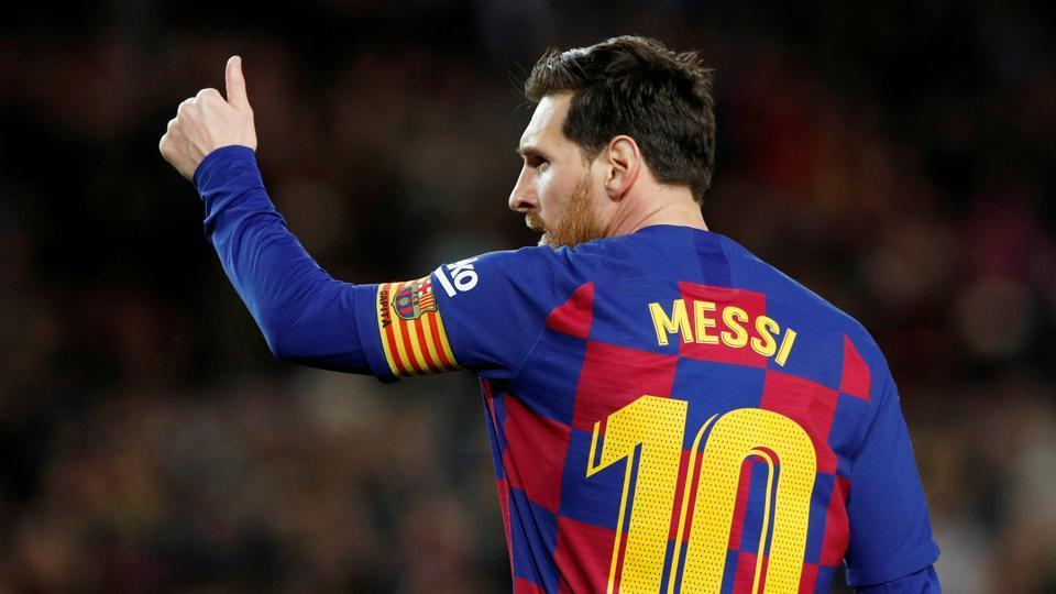 Barcelona's Lionel Messi celebrates scoring their first goal.