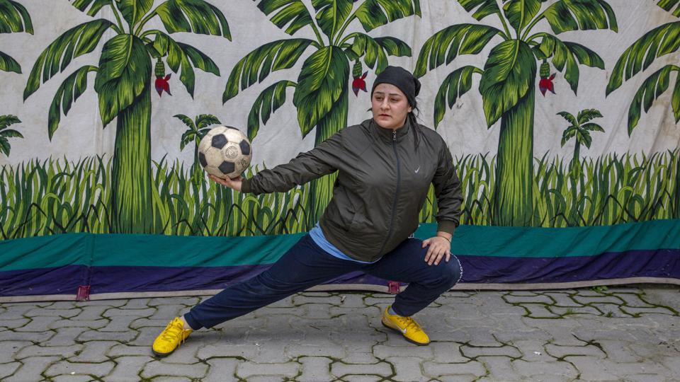 Kashmiri football coach Qudsiya Altaf poses for a photograph during practice inside a school compound that belongs to her father, near her home in Srinagar. Like many other athletes, the coronavirus pandemic has restricted Altaf to her neighbourhood. (Dar Yasin / AP)