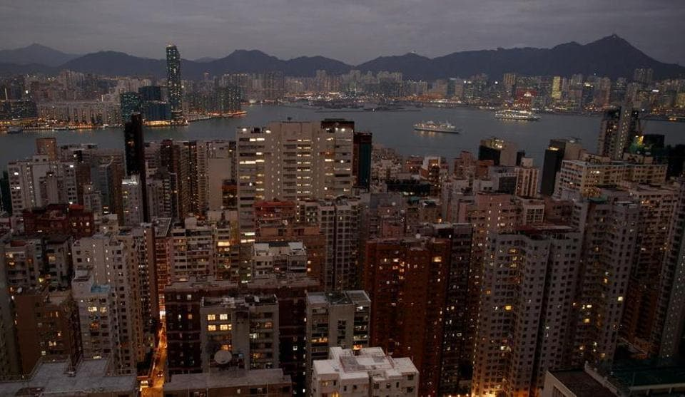 Lit-up buildings stand within the North Point and Fortress Hill district in Hong Kong, China, December 16, 2019.