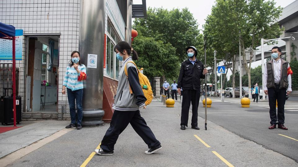 Senior school students returned to class on May 6 in the central Chinese city of Wuhan, where the coronavirus that has now swept the globe first emerged late last year.