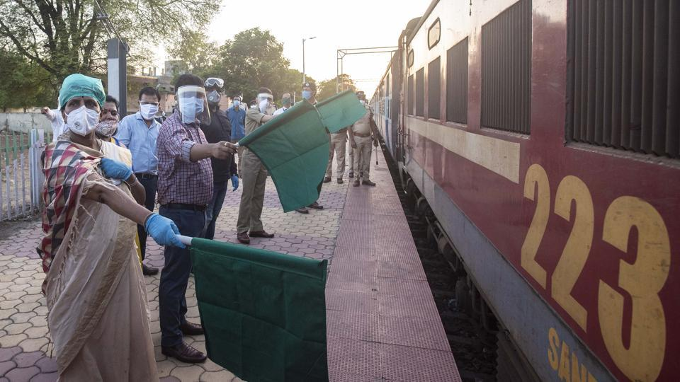 Naval Kishore Ram (2nd from left), District Collector waves flag for special train at Uruli railway station in Pune.