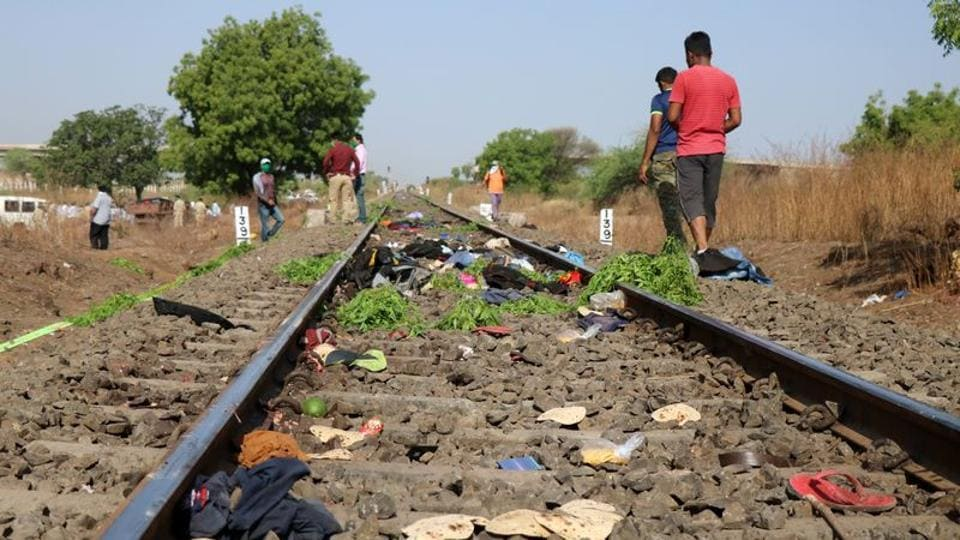 The belongings of victims lie scattered on the railway track after a train ran over migrant workers sleeping on the track in Aurangabad district in Maharashtra on May 8, 2020.