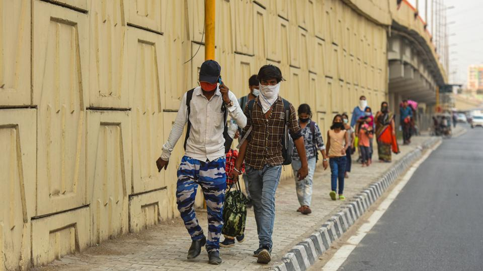 Migrant workers travelling to Madhya Pradesh walk from Ghazipur to their hometowns during lockdown in New Delhi.