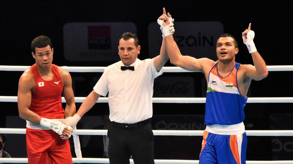 Vkas Krishan (in blue) after a victory