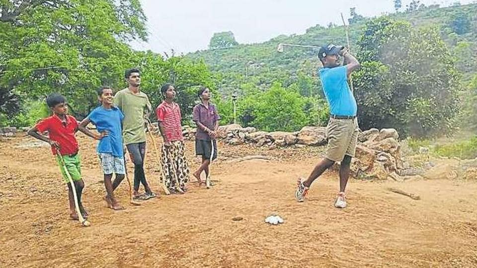 C Muniyappa is watched by, among others, his two sons and a daughter as he goes for a shot and (above) one of the two par-3 holes the Indian Open champ has meticulously built.