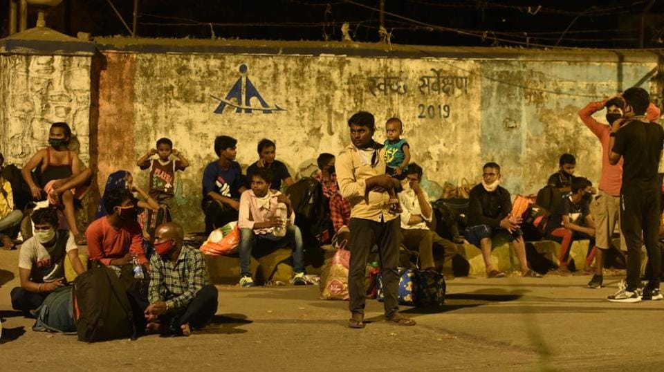 Migrants stranded near Dahisar check naka as they were not allowed to cross the Dahisar check naka by police personnel in Mumbai on Friday.
