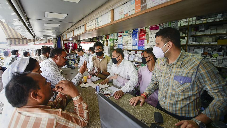Salesmen at a chemist shop wear protective masks in wake of the deadly novel coronavirus.