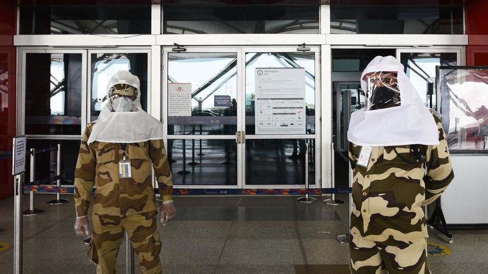 CISF personnel seen wearing protective headgear during lockdown, in Terminal 3 of IGI Airport, New Delhi, India, on Sunday, May 10, 2020.