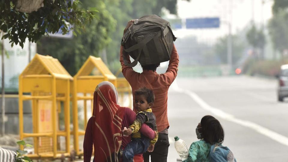 A family of migrants walk towards their village in Madhya Pradesh during lockdown, at Ring Road near ITO in New Delhi, India, on Sunday, May 10, 2020.