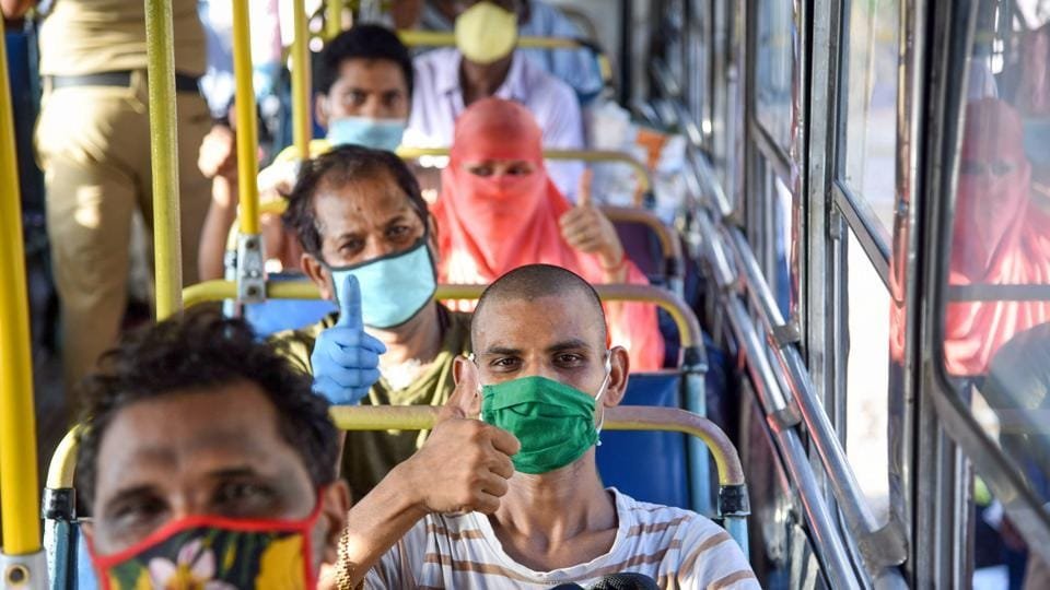 Migrants board NMMT buses at Turbhe MIDC Police Station to reach their native state Madhya Pradesh, during a nationwide lockdown in the wake of coronavirus pandemic, in Navi Mumbai, Sunday, May 10, 2020.