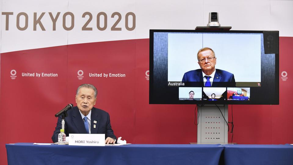 FILE - In this April 16, 2020, file photo, Tokyo 2020 Organizing Committee President Yoshiro Mori, left, speaks in teleconference with John Coates, chairman of the IOC's Coordination Commission for the Tokyo 2020 Olympic Games, in Tokyo.