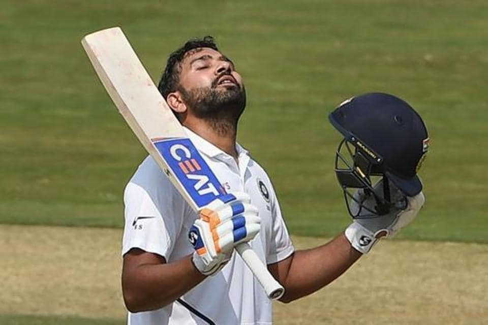 India's Rohit Sharma celebrates his century on the 1st day of the first cricket test match against South Africa at Dr. Y.S. Rajasekhara Reddy ACA-VDCA Cricket Stadium, in Visakhapatnam, Wednesday, Oct. 2, 2019.
