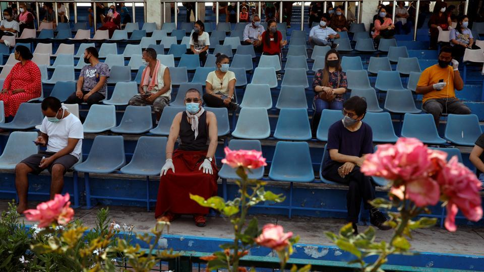 Stranded residents of Ladakh, a union territory in India, wait in a stadium for being thermal screened before taking buses back to Ladakh, after few restrictions were lifted by Delhi government during an extended nationwide lockdown to slow the spread of the coronavirus disease (COVID-19), in New Delhi.