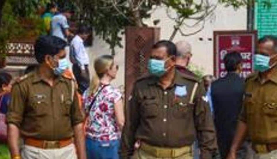 Police personnel wear masks as prevention against coronavirus, at Taj Mahal complex, in Agra, Wednesday, March 4, 2020.