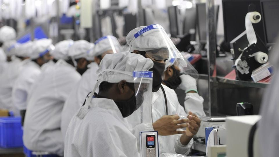 Work resumes after relaxations in lockdown restrictions at a mobile phone manufacturing facility in Sector 63, Noida.