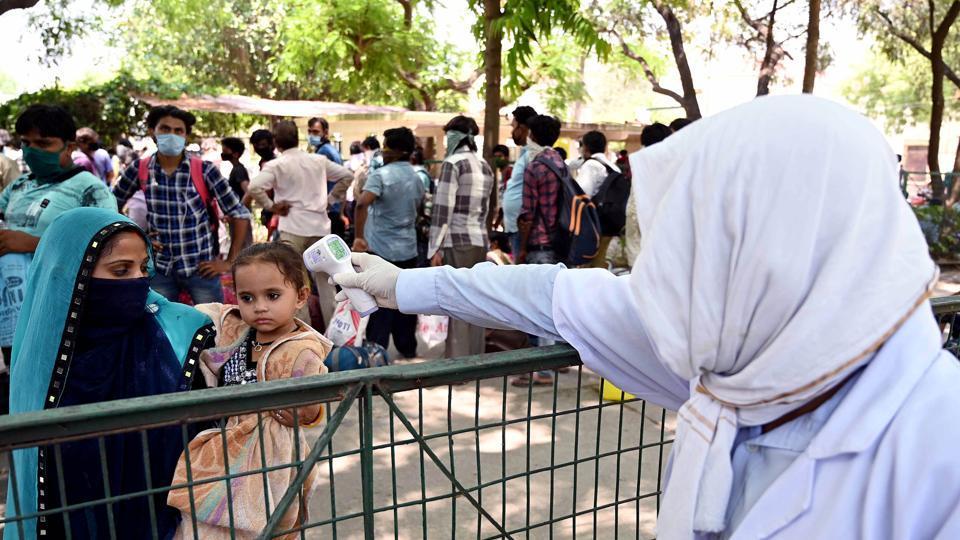 Medics conduct thermal screening of migrants