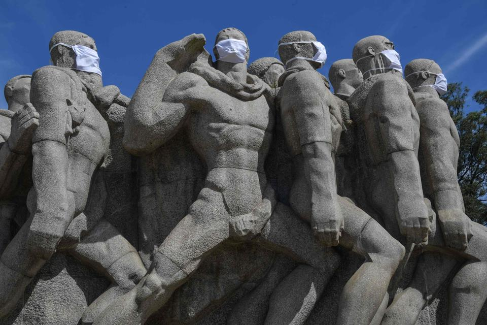 Statues of the Monumento das Bandeiras wear face masks in Sao Paulo, Brazil, May 12, 2020, during the Covid-19 pandemic