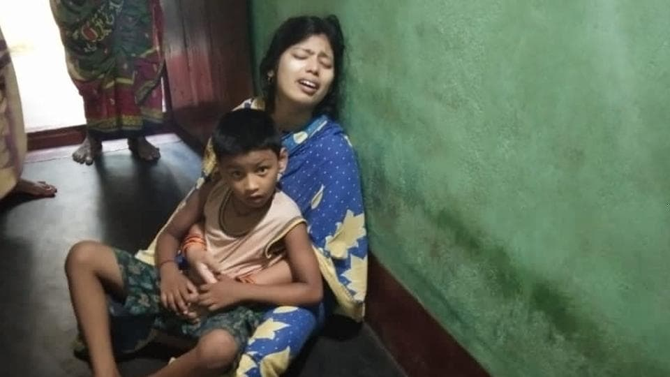 Wife and child of Satyaban Swain, who died after receiving injuries in a police lathi charge in Surat