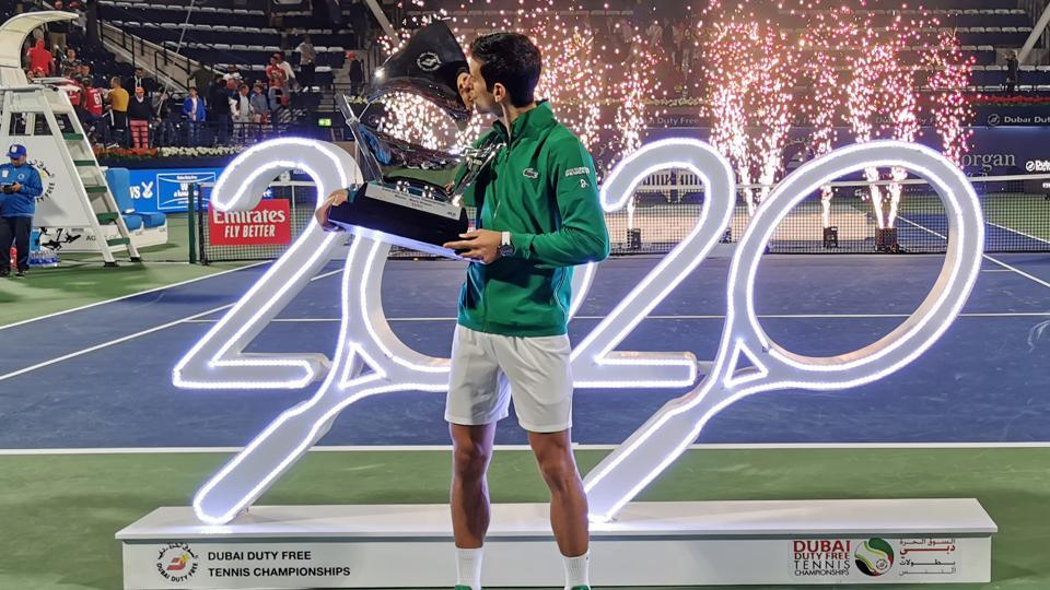 Tennis - ATP 500 - Dubai Tennis Championships - Dubai Duty Free Tennis Stadium, Dubai, United Arab Emirates - February 29, 2020 Serbia's Novak Djokovic kisses the trophy after winning the Final against Greece's Stefanos Tsitsipas