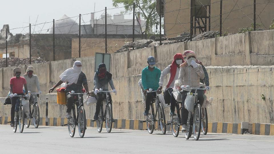 A group of migrant workers on newly bought bicycles pass Jaipur Agra highway on their way to Bihar during lockdown, in Jaipur, Rajasthan on Wednesday.