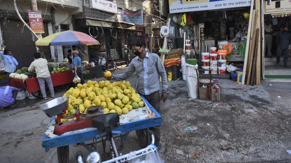 Shops open in a market during lockdown in Bharat Nagar, New Delhi.