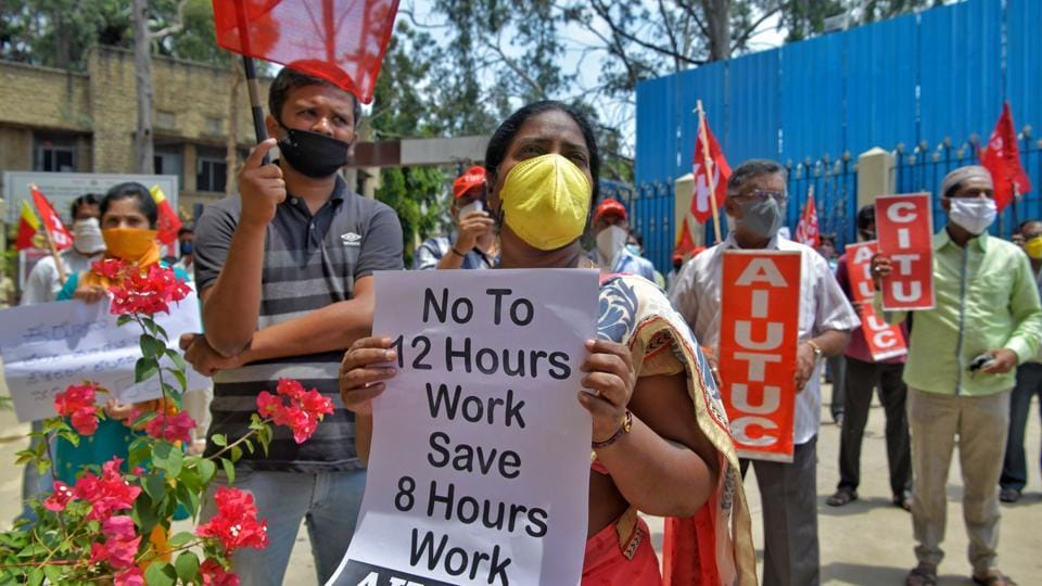 Activists of Joint Committee of Trade Unions (JCTU) take part in an anti-government protest against the increase in working hours of employees in various industrial sectors from 8 hours to 12 hours a day, near labour department in Bangalore.