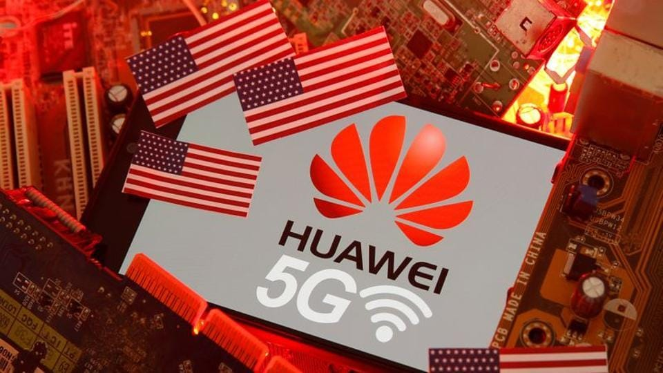 The U.S. flag and a smartphone with the Huawei and 5G network logo are seen on a PC motherboard in this illustration taken January 29, 2020.