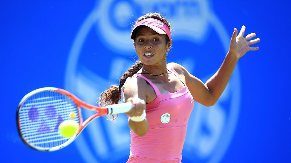 Ankita Raina of India hits a forehand during the qualifying match against Katy Dunne of Great Britain at Edgbaston Priory.