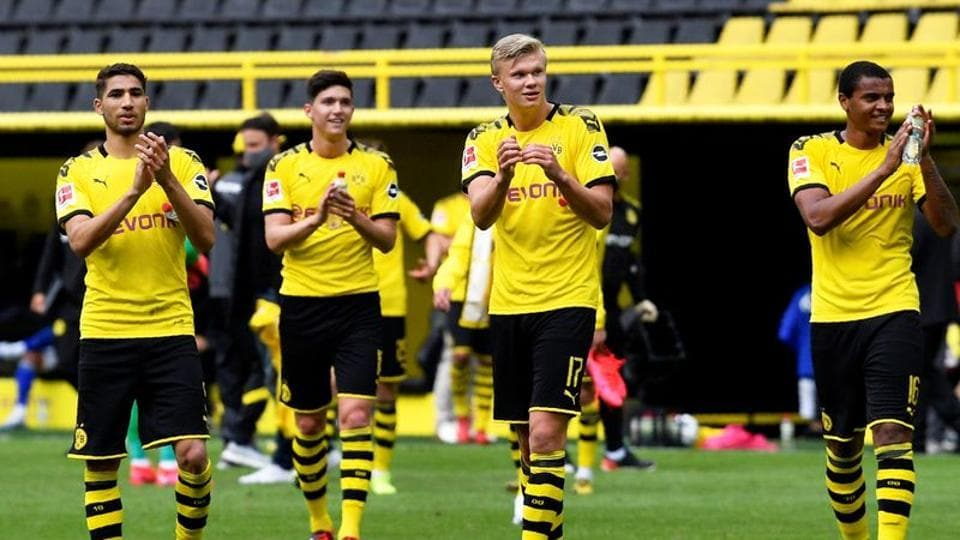 Dortmund's Erling Braut Haaland and teammates celebrate after the match.