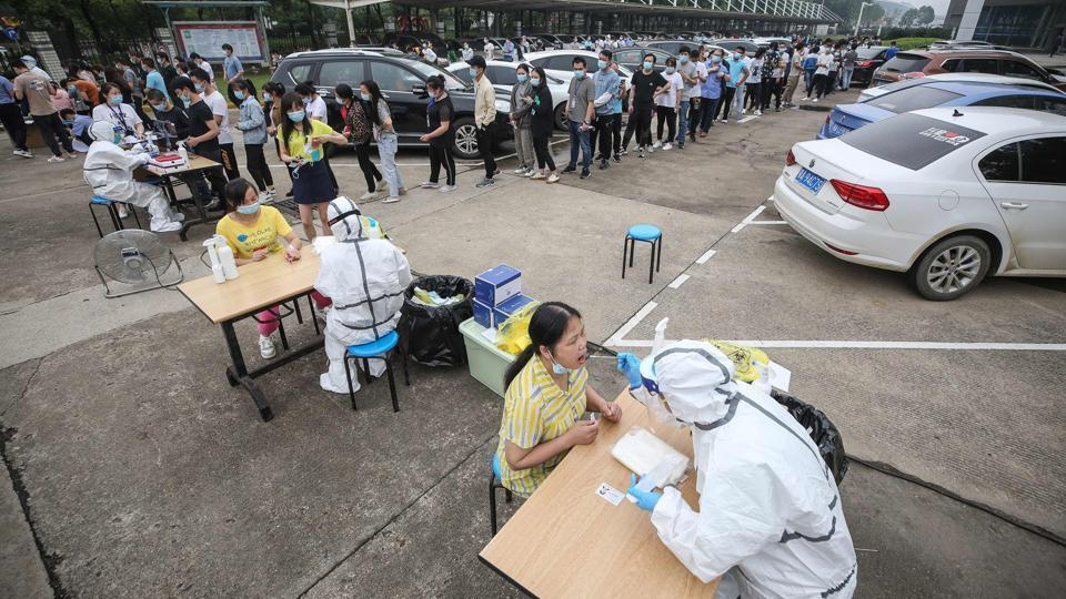 China's Wuhan nearly doubles number of Covid-19 tests per day